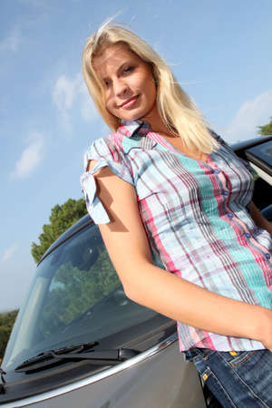 Young woman driving new car photo