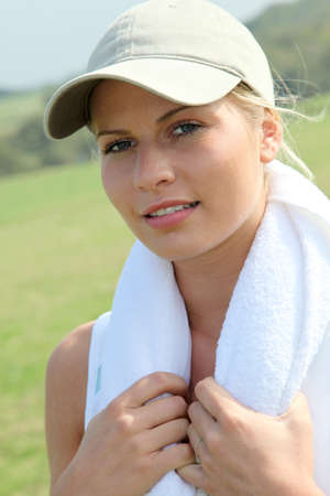 Beautiful blond woman with towel around her neck photo