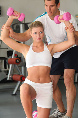 Closeup of woman working out in gym photo
