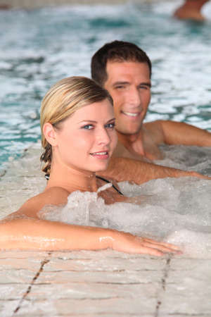 Couple bathing in jacuzzi of spa center  photo