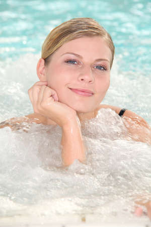 thalasso: Beautiful woman bathing in jacuzzi of spa center
