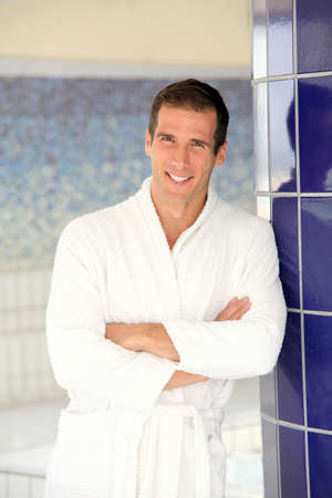thalasso: Man with bathrobe standing by spa pool Stock Photo