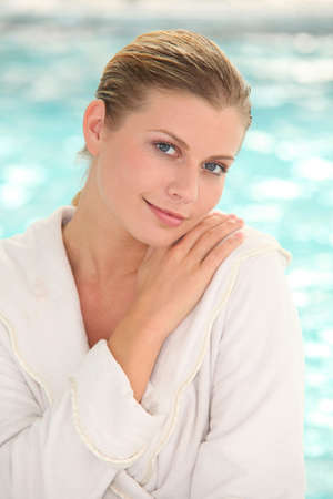 thalasso: Beautiful woman with bathrobe standing by spa pool