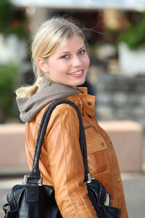 Blond woman doing shopping in town photo