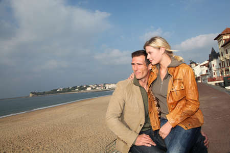 Lovers at the beach in autumn Stock Photo - 8088755