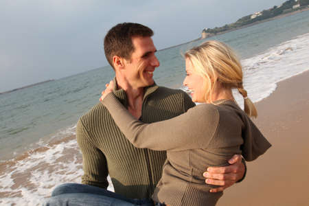 first date: Lovers at the beach in autumn
