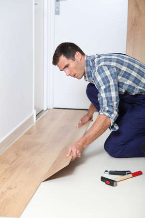 Closeup of artisan installing flooring in room Stock Photo - 8088381