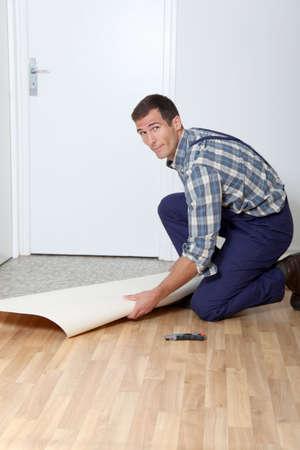 reforming: Closeup of artisan installing ground floor in room