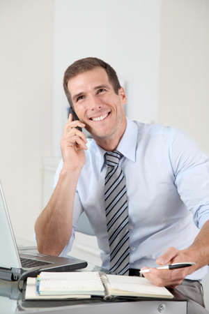 Man talking on the phone in the office  photo