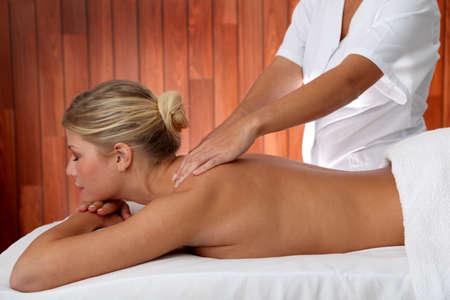 Closeup of beautiful woman laying on a massage bed photo