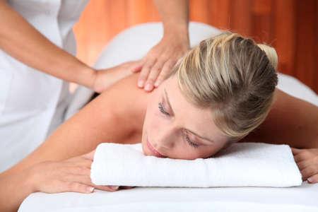 thalasso: Closeup of beautiful woman laying on a massage bed Stock Photo