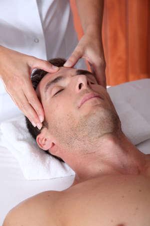 Man having a facial massage in spa center Stock Photo - 8124359