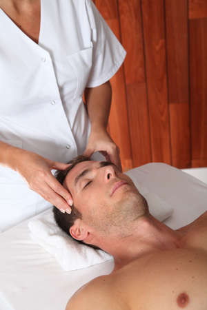Man having a facial massage in spa center Stock Photo - 8124348
