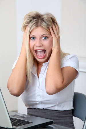 going crazy: Businesswoman going crazy in the office
