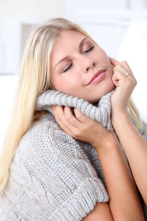 cocooning: Beautiful blond woman realxing at home in winter