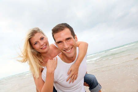 Happy couple enjoying vacation on a sandy beach photo