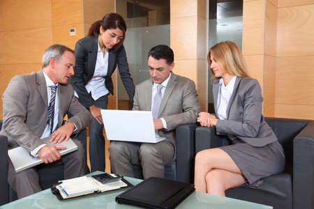 Group of associates meeting in lounge Stock Photo - 8258580