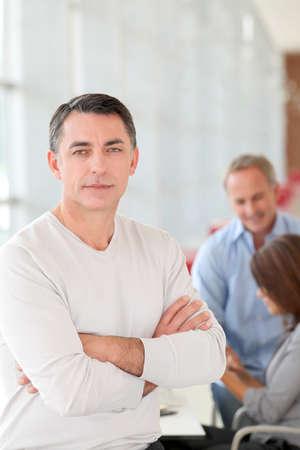 men 45 years: Businessman in work meeting