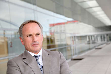 Businessman standing outside modern building Stock Photo - 8258526