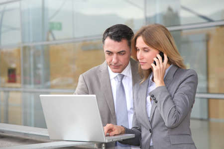 Sales people working outside modern building photo