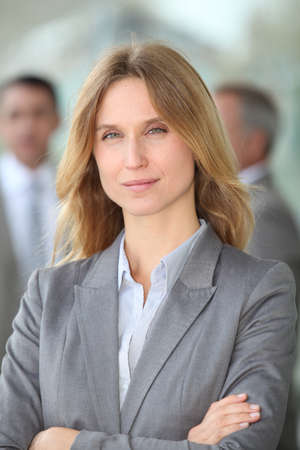 business exhibition: Closeup of blond businesswoman standing outside