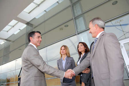 sales meeting: Business people meeting at an exhibition