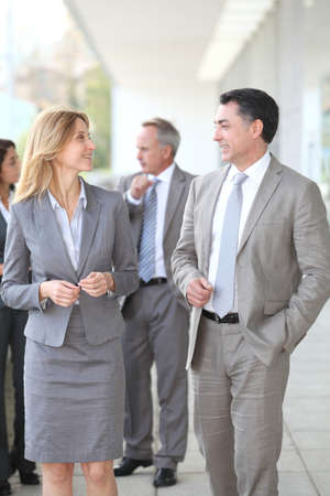 Business people walking outside a congress center photo