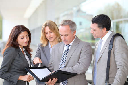 Business people meeting at an exhibition Stock Photo - 8258615