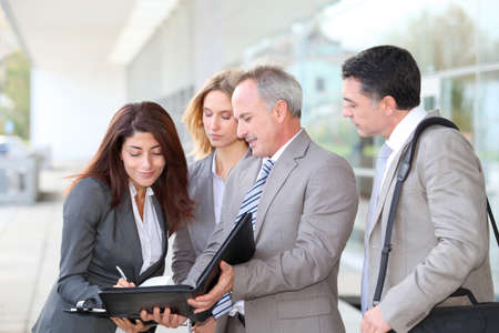 Business people meeting at an exhibition photo