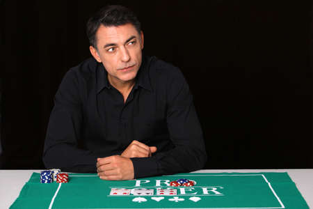 Man sitting at poker table photo