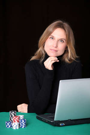 Woman gambling on internet photo