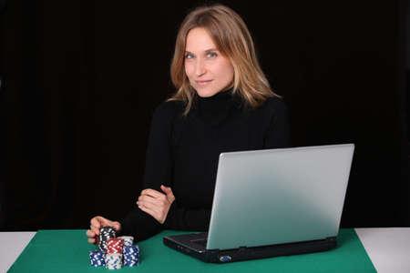 croupier: Woman gambling on internet Stock Photo