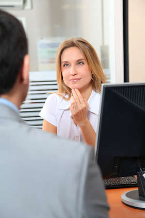 Man meeting financial adviser in office photo