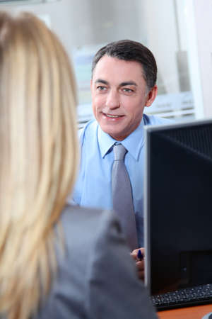 Woman meeting financial adviser in office photo