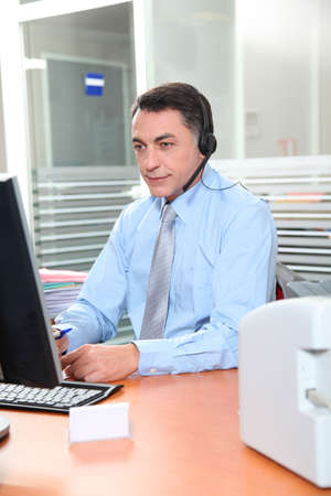 councilor: Adult man in the office talking on the phone Stock Photo
