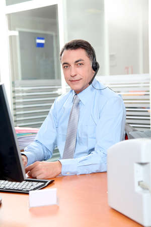 Adult man in the office talking on the phone Stock Photo - 8258378