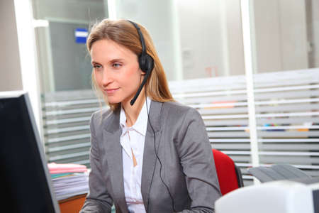 councilor: Blond office worker with headphones