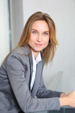 councilor: Portrait of blond businesswoman in grey jacket