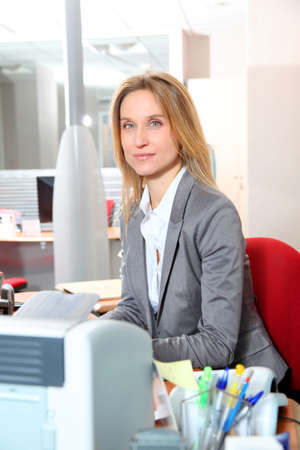 councilor: Blond businesswoman working in the office Stock Photo