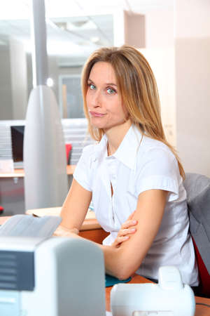councilor: Blond woman working in the office