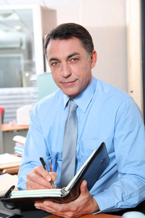 councilor: Businessman with blue shirt working in the office