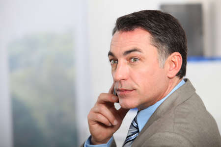 Closeup of businessman talking on the phone  photo