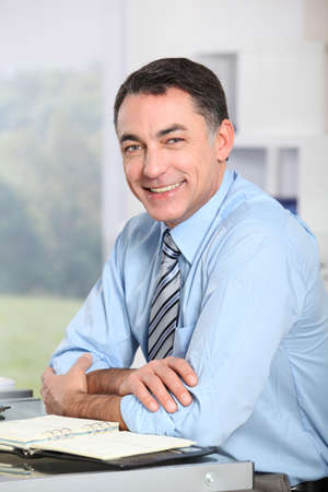 Closeup of smiling businessman in the office photo