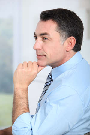 men 45 years: Closeup of businessman with blue shirt and tie Stock Photo