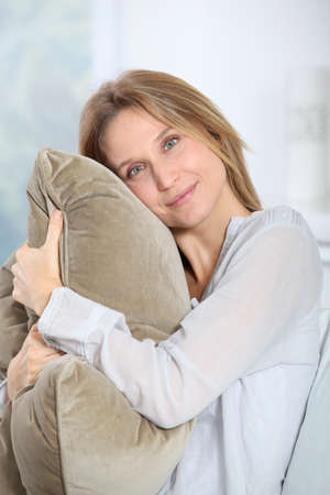 cocooning: Closeup of beautiful blond woman relaxing at home Stock Photo