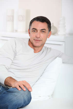 Closeup of handsome man relaxing in sofa Stock Photo - 8360665