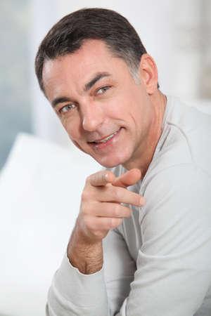 Closeup of handsome man pointing at camera photo
