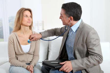 auscultation: Doctor examining patient