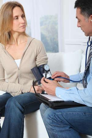 auscultation: Doctor measuring blood pressure