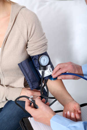 Doctor measuring blood pressure photo